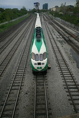 GO Train, Bathurst Street Bridge, Toronto (Tony Lea) Tags: street bridge white toronto ontario canada green station train canon lens rebel track angle cloudy union go wide tracks fast sigma windy wideangle tony transit choo lea anthony commuter commuting below mm horn curve 1020mm railyard 1020 loud bathurst reserved westbound toot eastbound motoring xti barreling tonylea anthonylea
