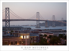 San Francisco Oakland Bay Bridge, Dusk (G Dan Mitchell) Tags: sanfrancisco park travel bridge sunset sky urban west tree water night ball buildings landscape island lights oakland evening bay downtown apartments waterfront treasure baseball dusk stadium stock scenic palm deck upper embarcadero giants yerbabuena span att condominiums
