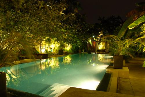 Swimming pool at night at Blue Lime Hotel, Phnom Penh