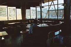 afternoon tea (Adele M. Reed) Tags: man film bar 35mm canon eos cafe alone shadows kodak browns 200 coventry