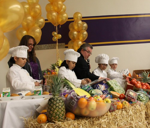 Salida Union School District's Child Nutrition Services Director, Chef Billy Reid (right), Tammy Zeiger (left), a member of his team, and several students demonstrate how to cook a healthy school lunch using USDA Foods.