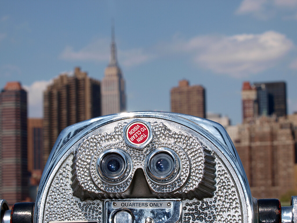 Coin-Operated Tourist Telescope In Queens Looking At The Empire State Building Out Of Focus In The Back; Taken From Gantry Plaza State Park In Queens, New York