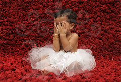 Peek-a-boo (Rawan Mohammad ..) Tags: she boy red portrait baby white cute art girl kids children photography kid nikon artist photographer child dress little photos d peekaboo australia shy brisbane mohammed fells saudi arabia tamron bit mohammad 2010 rn   2011 rawan               d300s rnona     almuteeb