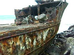 Rusting Shipwreck in Samoa (2) (Herb In Hawaii) Tags: ocean sea cliff water island rust ruins rocks waves treasure cloudy bluewater shipwreck blowhole damage samoa rusting herb wrecked americansamoa bluesea roadstop southpacificocean koreanfishingboat