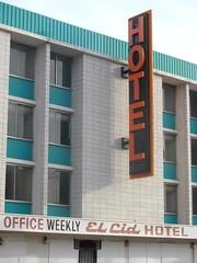 El Cid Hotel (Nick Leonard) Tags: city windows orange white black building hotel office downtown lasvegas teal nevada bricks nick brickwall weekly elcid nickleonard