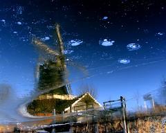 Windmill in ice (Art Rock (Hennie)) Tags: reflection ice topf25 netherlands windmill topf50 topf75 canonpowershotpro1 rijssen explored artrock2006 pelmolen platinumheartaward hennieschaper hennieschapertop100