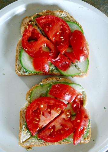 pesto cream cheese, cucumber, and tomato toast