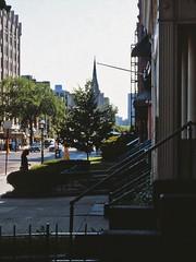 Newbury Street Morning (AntyDiluvian) Tags: street morning film boston 35mm minolta massachusetts steps newburystreet streetscene steeple scanned 1970s seventies backbay srt101 bostonist stoops