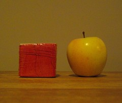 T-shirt cube, next to an apple for scale