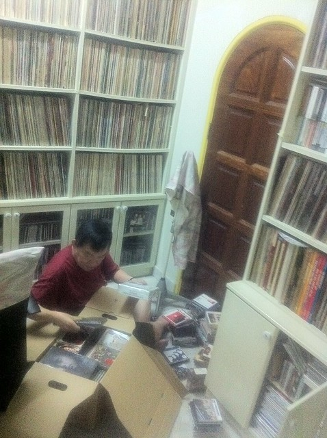 Dad going through Zeg Zeg's record collection