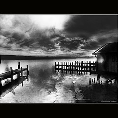 Piers and a boatshouse in Starnberg (MyOakForest) Tags: winter bw lake alps dark bayern bavaria see sw alpen starnberg dunkel supershot aplusphoto