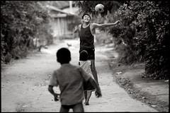 Gooooal !! (fly) Tags: playing kids football asia lao luangpranbang fly simonkolton