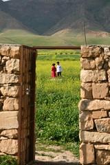 kids in field (delikizinyeri) Tags: door flowers playing green stone wall turkey children gate tomb hasankeyf zeynelbey