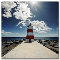 The Littlest Lighthouse, Portimao, Portugal (s0ulsurfing) Tags: blue light shadow red sea sky cloud sunlight lighthouse seascape beach portugal water weather rock clouds contrast square bay coast rocks lighthouses skies shadows wind pov stripes wide perspective shoreline fluffy wideangle pointofview coastal shore cumulus flare april getty coastline rays nautical algarve humilis sunrays shafts 2009 beams squared nube bold sunbeams meteorology nephology praiadarocha 10mm portimao sigma1020 s0ulsurfing rioarade cumulushumilis aplusphoto infinestyle bratanesque vertorama