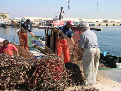 fishermen cleaning the nets in gallipoli