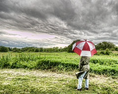 Have you ever seen the rain? (_Robert C_) Tags: park nyc selfportrait ny rain weather clouds umbrella wind sigma wideangle statenisland 1020mm greenfield raincoat hdr d300 photomatix mountloretto topazadjust robertcatalano