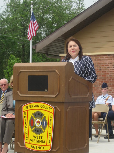 Tammye Trevino, Rural Development Housing Administrator, addresses the audience at the dedication.