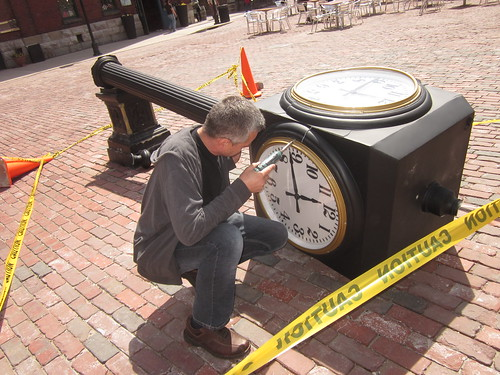 Thomas the electrician works on the clock in the distillery district that has had been broken this spring