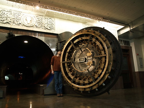 an old bank vault door with a person standing in it
