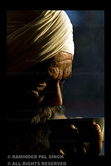 Morning Tea (Raminder Pal Singh) Tags: light shadow portrait india white dark beard eyes hand tea religion oldman moustache 1d portraiture sikh gurdwara punjab amritsar afc shadowcasting headgear lightandshade canonshot indianman canon1d silverbowl raminder drinkingtea earlymorningtea moustacheandbeard shotinthemorning sikhman morningimage memorycornerportraits sikhdevotee shotoncanon canonusershot sikhmandevotee sikhmaningurdwara manhavinglangartea mandrinkingtea manhavingtea enjoyingtea oldsikhdevotee thinkingwhilehavingtea holdingabowl havingteainabowl
