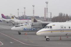 Old and New Antonov Noses (Treflyn) Tags: plane airplane airport ukraine aeroplane 24 airlines ukrainian kiev airliner vv 140 unmarked kbp antonov borispol lugansk aerosvit an24 an140 ur47312 ur14006