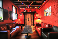 Little Italy (` Toshio ') Tags: door red food brick window lamp painting table lights restaurant cozy italian chair italia wine interior room maryland baltimore christmaslights couch shutters littleitaly redroom hdr hardwoodfloor winebottles brickred toshio highdynamicresolution aplusphoto amiccis