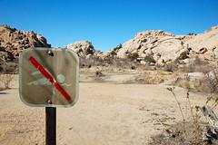 Irony (colin grubbs) Tags: california sky usa sign nationalpark rocks humor joshuatree irony ironic noswimming nikond40