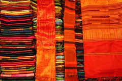 Colours from the night market (... Arjun) Tags: pink blue shadow red 15fav orange color colour green texture topf25 colors yellow night 1025fav contrast 510fav 35mm canon river asia colours dof market buddhist tranquility buddhism 100v10f textile 2550fav textiles laos 2009 f4 tranquil mekong luangprabang indochina luangphrabang dimlight happymothersday luangphabang louangphrabang canonef24105mmf4lis bluelist iso2000 laospdr unescoworldheritagecity canoneos5dmarkii mightymekong 5dmarkii thsisavangvong thkitsarat