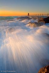 Early Morning Surfer (-yury-) Tags: ocean morning sea sky sun seascape beach water pool sunrise canon rocks surf waves surfer sydney australia nsw 5d avalon