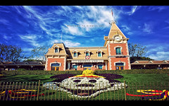 Welcome to Disneyland (isayx3) Tags: flowers blue sky clouds mouse nikon mainstreet angle disneyland wide entrance mickey trainstation 24mm f28 d3 singleexposure nonhdr plainjoe isayx3