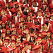 Graduates watch as classmates file into the 2011 Spring Commencement in the RBC Center.