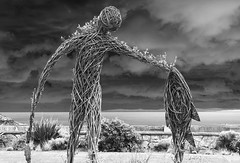 Wicker Man (Anthony Owen-Jones) Tags: ocean uk sea sky blackandwhite bw sculpture white man black art monochrome wales clouds canon lens eos rebel mono coast photo kiss europe moody unitedkingdom north gimp kit wicker postprocess conwy t3i x5 rhosonsea northwales rhos 600d takenwith canonefs1855mmf3556is rebelt3i kissx5