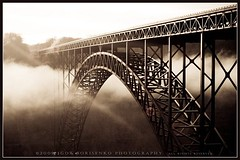 New River Gorge Bridge in Fayetteville, West Virginia (:: Igor Borisenko Photography ::) Tags: cloud sun mist west sepia river virginia arch artistic creative beam wv valley longest 1977 newrivergorgebridge allrightsreserved igorborisenkophotography