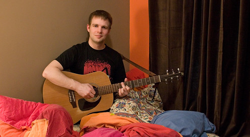 Tom Goss loves to play the guitar in bed, anyone's bed. (This is Marc's bed)