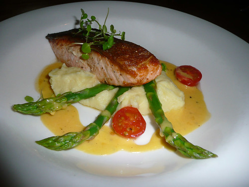 Tasmanian salmon on mashed potato with asparagus, cherry tomatoes and ...