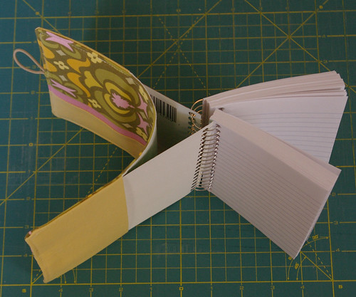 Open up journal as shown and slide front and back into pockets by you.