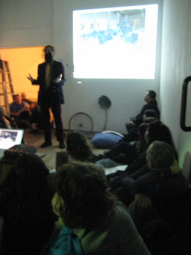 me giving a talk as kaprow