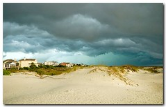 Ominous Tybee Island Georgia Beach (:: Igor Borisenko Photography ::) Tags: blue light sky sun storm green beach yellow clouds ga georgia scary sand dramatic cell super thunderstorm savannah nikkor allrightsreserved dunnes tybeeislandbeach nikond80 nikon1755mmf28 igorborisenkophotography