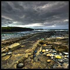 Rocks and the Storm Rolls (|sumsion|) Tags: ireland storm landscape nikon tripod may cliffs 2009 hdr highdynamicrange bracketing sigma1020mm d90 sumsion photmatix nikond90 sumsioncom
