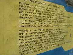 Jamaica's national anthem is painted onto the school wall (bbcworldservice) Tags: world school girls boys field athletics downtown track stadium assignment champs christopher coke lord kingston national bbc jamaica drug service athletes 2010 dudus