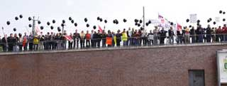 German workers formed a human chain around the meeting venue and released black balloons.