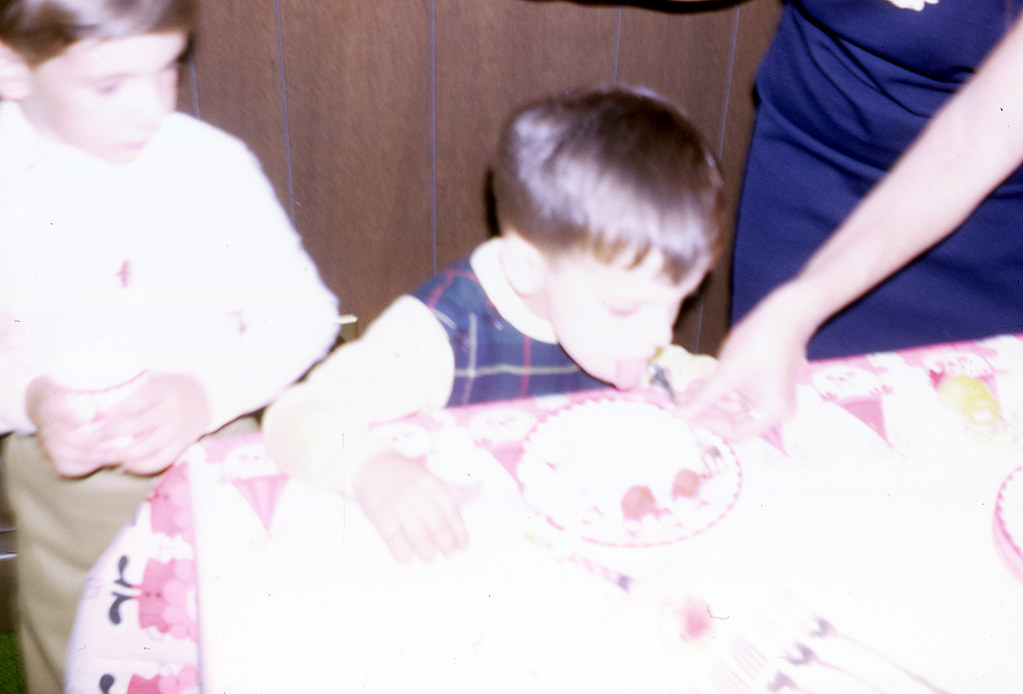Tommy licking his cake