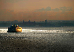 Ferry in New York Harbor (Rick Elkins) Tags: newyorkcity light sunset sunlight newyork water ferry dark harbor ship statenislandferry ellisisland newyorkharbor infinestyle rickelkins