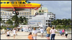 (Casey Veranth) Tags: yellow airplane low landing sunsetbeach caravan stmaarten maho cessna sxm dhl courrier mahobeach sonesta islanderclub