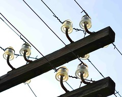 Outdated Electrical Grid? (IRainyDays) Tags: glass grid twisted electriclines glassinsulators