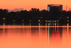 Orange World (ionut iordache) Tags: sunset sky orange lake canon catchycolors worldtradecenter romania bucharest bucuresti herastrau canonef75300mmf456iiiusm canon450d canoneos450d platinumheartaward canondigitalrebelxsi sunsetsandsunrisesgold