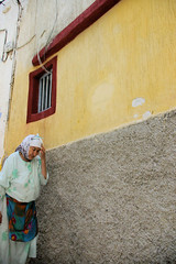 Woah Is Me the Moroccan Woman (cwgoodroe) Tags: ocean africa street old city sea summer people sun fish bus colors metal ferry plane children cafe sand ancient colorful doors artistic pentax vibrant muslim poor streetlife mosque arabic panasonic doorway morocco arab friendly moors conservative script casbah vegtable merchants continent merchant christians tangier monger moroccan tanger kasbah cleric sadfaces metaldoors fishmerchant casba casbha dailylifeportrait
