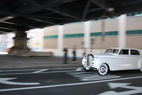 White rolls goes past under the Manhattan Bridge