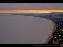 Dawn Volcano: Early Light Over Kapiti (tomraven) Tags: ocean light sea newzealand sky orange sun beach clouds sunrise reflections geotagged grey dawn lights volcano coast interestingness surf streetlights framed explore northisland coastline frontpage 2009 ruapehu kapiti mtruapehu kapiticoast explored explorefrontpage inexplore ruapehunz explorefp fbdg tomraven geo:lat=41004224 geo:lon=174938263 q209