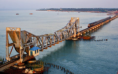 The Pamban Bridge...!!!! (prabhakaran.s) Tags: sunset india colors beautiful beauty landscape availablelight beaches chennai ontheroad tamilnadu rameswaram downsouth southindia bayofbengal pamban handheldshot canon400d prabhakaran tamron28200lens blueskieslandscape psmjulycompetition